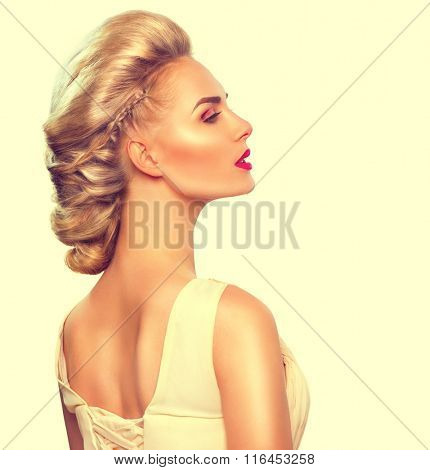 Fashion Model Girl Portrait with Updo hair style. Beautiful bride with fashion wedding hairstyle. Beauty Woman with Modern Hairstyle and perfect glamour make up. Blonde hair. Beautiful blond lady