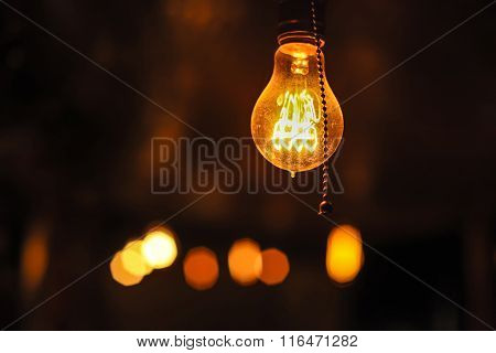 Glowing Edison's Light Bulbs On The Dark Background.