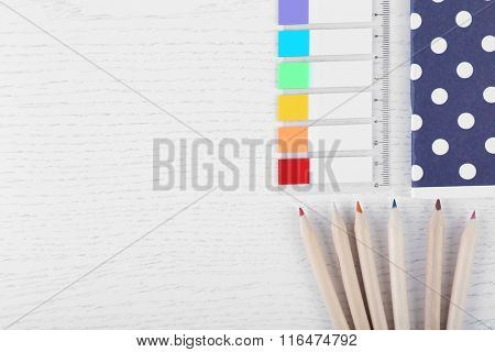 Notebook with rulers and pencils on a white table