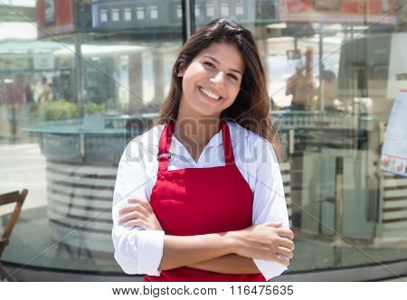 Laughing Caucasian Waitress In Front Of The Restaurant