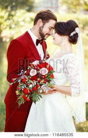 Bride And Groom Embracing, Wedding Couple, Dark Red Color Marsala Style Design. Suit With Bow Tie