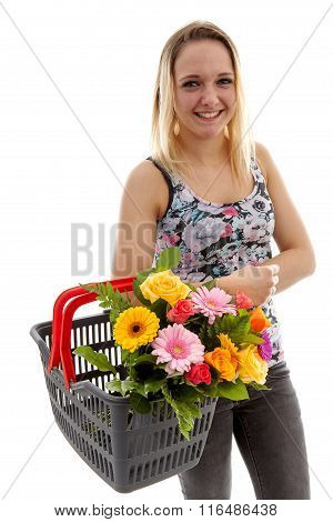 Young Woman Is Holding Basket With Bouquet Of Colorful Flowers