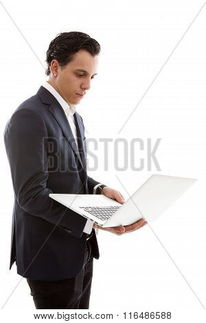 Young Businessman Is Holding Laptop