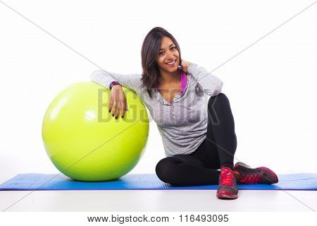 Sporty woman with a fitness ball
