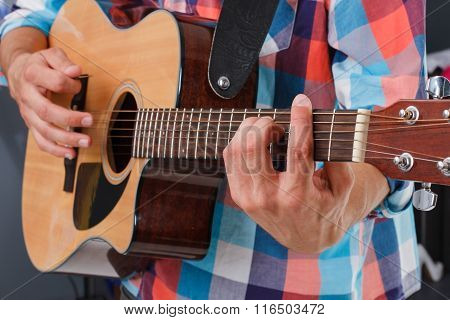 Acoustic guitar being played.