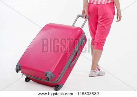 Girl traveller with pink suitcase.