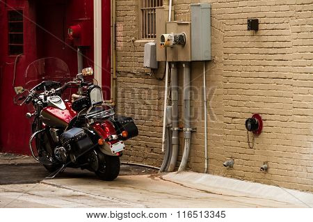 Motorcycle In An Alley