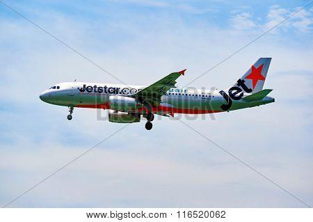 HONG KONG - JUNE 04, 2015: Jetstar aircraft landing at Hong Kong airport. Jetstar Airways Pty Ltd, trading as Jetstar, is an Australian low-cost airline headquartered in Melbourne, Australia