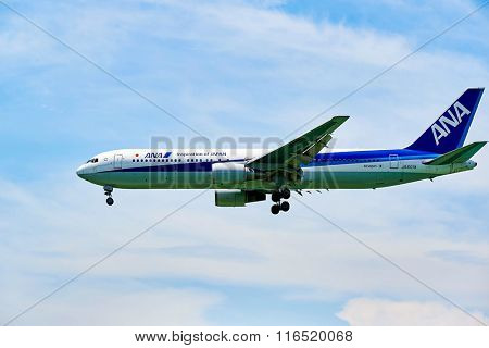 HONG KONG - JUNE 04, 2015: ANA aircraft landing at Hong Kong airport. All Nippon Airways Co., Ltd. also known as ANA, is the largest airline in Japan.