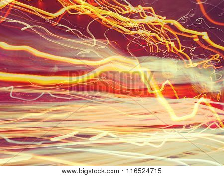 Abstract glowing background, blurry car lights, long exposure, traffic on the road, slow motion, creative wallpaper