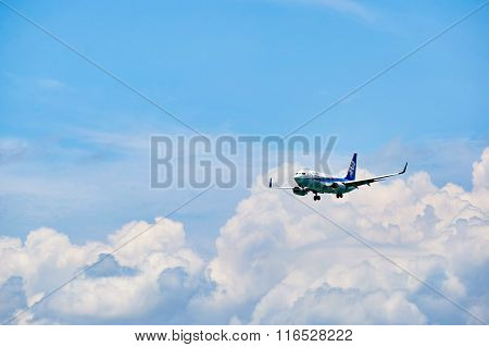 HONG KONG - JUNE 04, 2015: ANA aircraft landing at Hong Kong airport. All Nippon Airways Co., Ltd., also known as ANA, is the largest airline in Japan