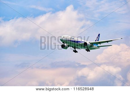 HONG KONG - JUNE 04, 2015: All Nippon Airways aircraft landing at Hong Kong airport. All Nippon Airways Co., Ltd., also known as ANA, is the largest airline in Japan