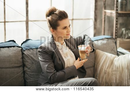 Young Businesswoman Is Sitting On Couch With Cup Of Coffee