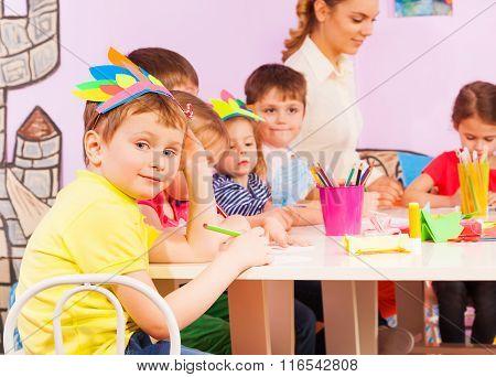 Portrait of boy in kindergarten group