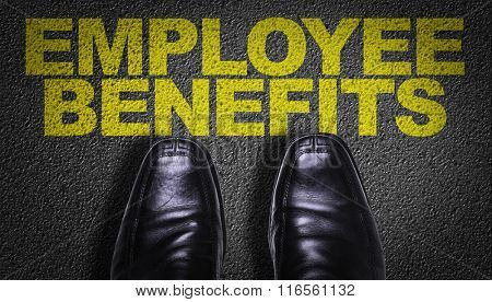 Top View of Business Shoes on the floor with the text: Employee Benefits