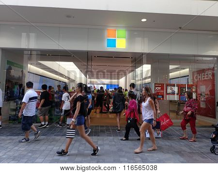 People Walk By Microsoft Windows Store On Black Friday