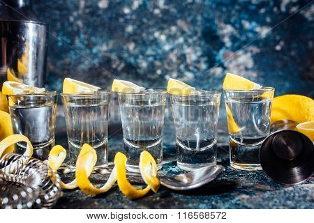 Tequila Shots With Lemon Slices And Cocktail Details. Alcoholic Drinks In Shot Glasses Served In Pub