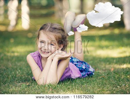 Little girl resting on meadow