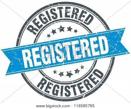 registered blue round grunge vintage ribbon stamp