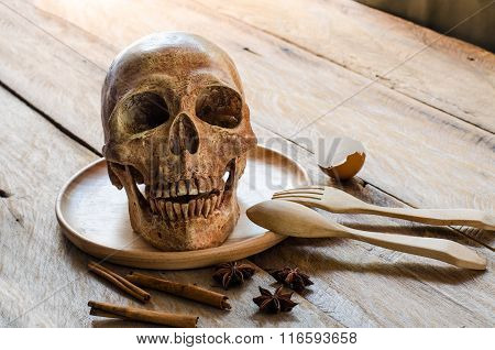 Skull Plate Placed On Wood - A Dangerous Concept. Surveillance About Eating.