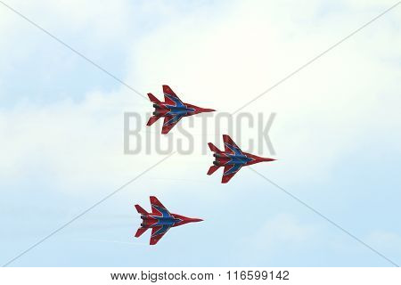 Perm, Russia - Jun 27, 2015: Three Mig 29 Fighter Aircrafts Fly Away In Sky On Airshow Wings Of Parm