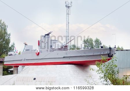 Military Grey Boat With Machine Guns On Pedestal Near Shipbuilding Plant