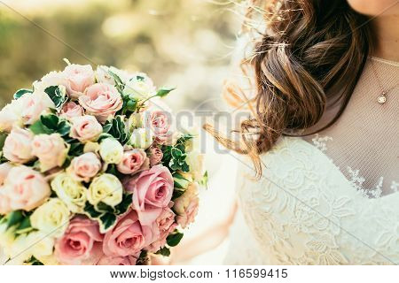 beautiful heir of bride holding wedding bouquet