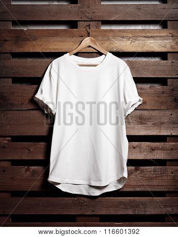Blanc white tshirt hanging on wood background