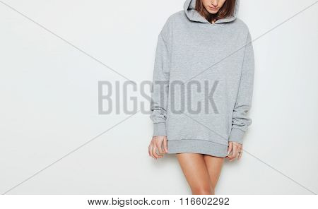 Young girl wearing blank and oversize long hoody. White background