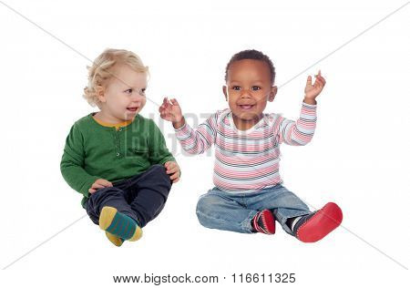 Couple of babies sitting on the floor isolated on a white background