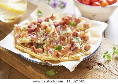 Pizza with smoked meat and onion