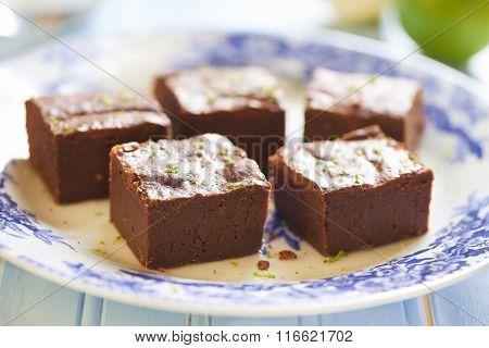 Homemade chocolate brownie with lime and lemon