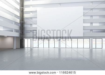 Blank White Billboard In The Hall Of Empty Building With Concrete Floor, Mock Up