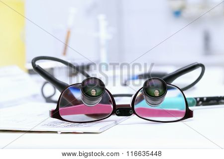 Special Dentist's Eyeglasses With Reflection Of Young Smiing Woman