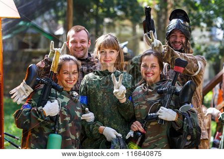 Happy Team Of Five Paintball Players Outdoors