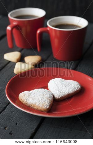 Red Cup And Cookie Hearts On A Black Background