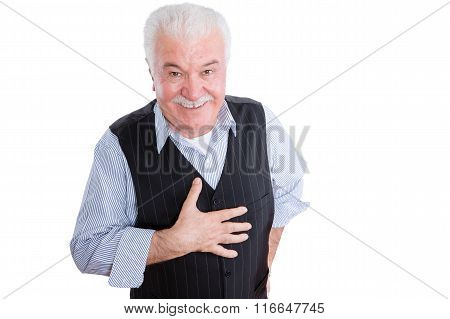 Respectful Senior Man With Hand On Chest