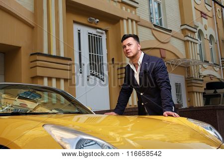 Stylish man posing with convertible sport-car and property poster