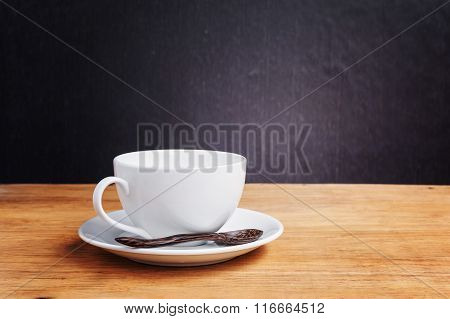 White Cup Of A Coffee In Dark Tone