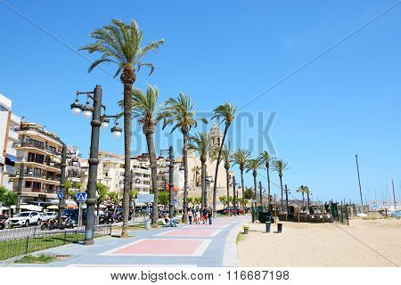 Sitges, Spain - May 23: The Tourists Enjoiying Their Vacation At Seafront On May 23, 2015 In Sitges,