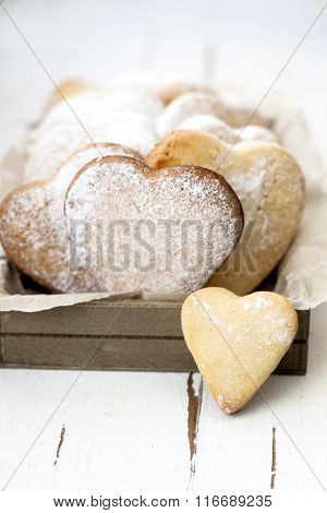 Delicious Cookies With Hearts To Valentine's Day On A White Wooden Background