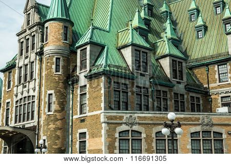 Quebec City Quebec Canada - Sept. 9 2015: Windows poke out along the rooflines of an historic government building in Quebec City.