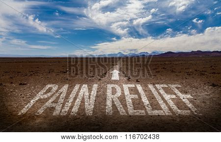 Pain Relief written on desert road