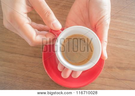 Hands Holding Cup Of Hot Coffee