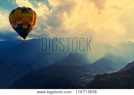 Colorful Hot-air Balloons Flying Over The Mountain With Sunbeam Or Ray.