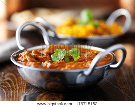 indian butter chicken curry in balti dish shot with selective focus