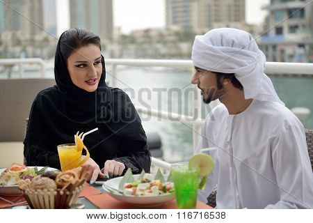 Young Emirati arab couple dining at a restaurant in Dubai poster