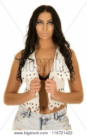 Woman In White Vest And Black Bra Look Straight Ahead