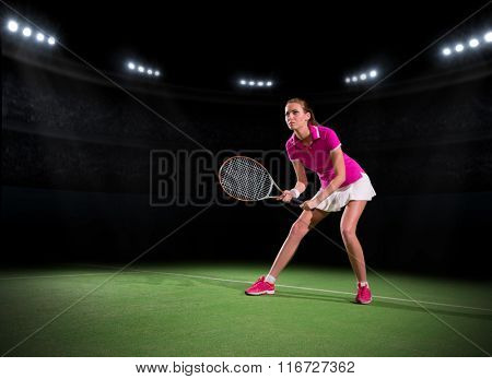 Young woman tennis player at stadium