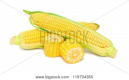Two Whole And Pieces Of Ripe Corn On The Cob With Green Leaves (isolated)